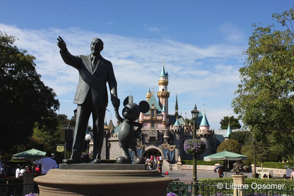 Dl Disneyland Castle With Statue Of Walt Disney And Mickey Mouse